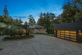 A detached, two-car garage stands beside the Mill Valley home.