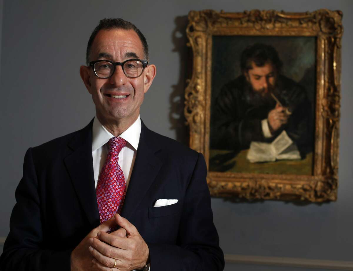 """Fine Arts Museums director Colin Bailey stands in front Pierre-Auguste Renoir's, portrait of """"Claude Monet"""" which is apart of the """"Intimate Impressionism"""" exhibit, Monday April 21, 2014 at the Legion of Honor Museum in San Francisco, Calif."""