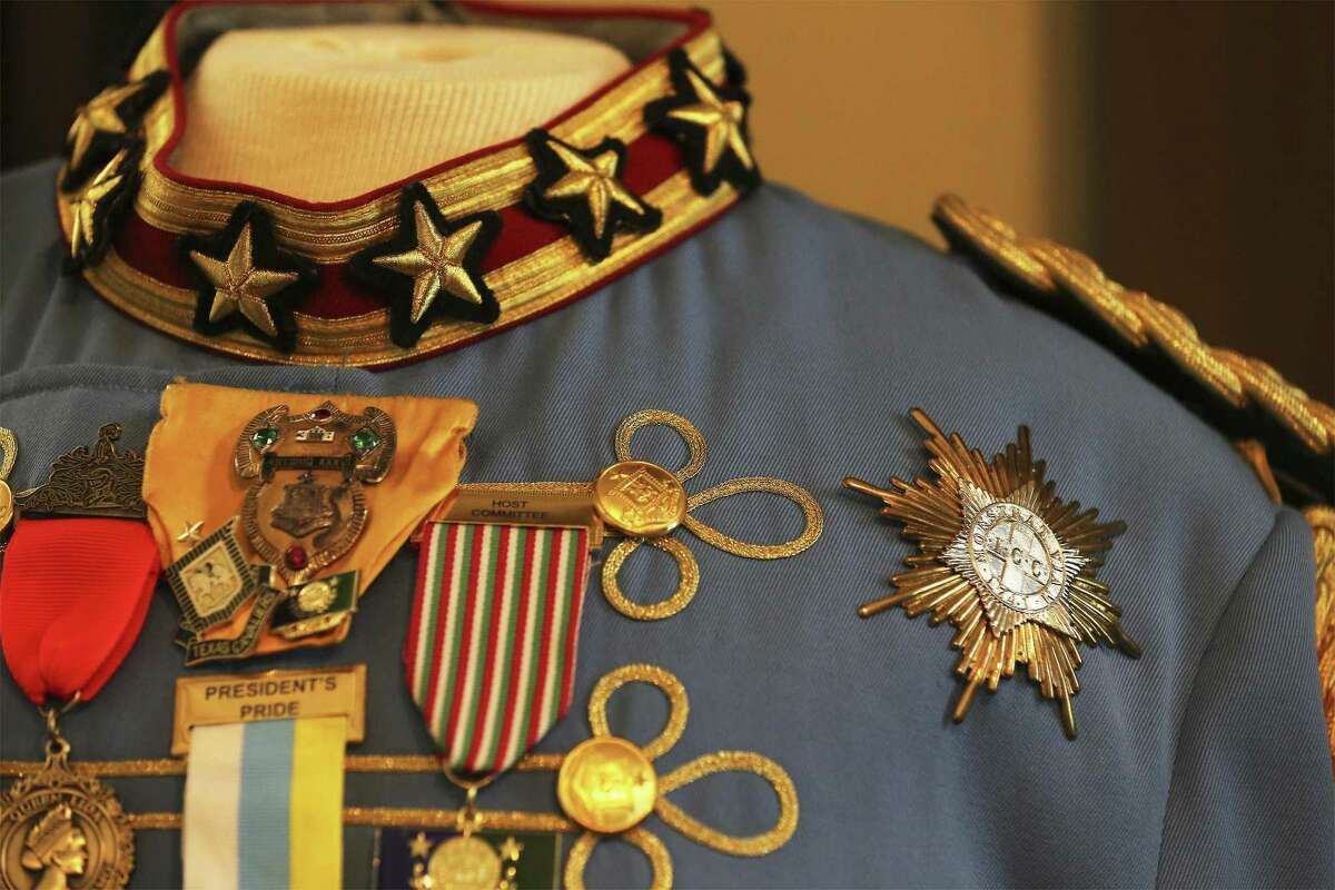 Detail of medals and collar on the uniform worn by Sam Bell Steves, who reigned as King Antonio LXXXII in 2004 is seen on display at the Steves Homestead on Thursday.