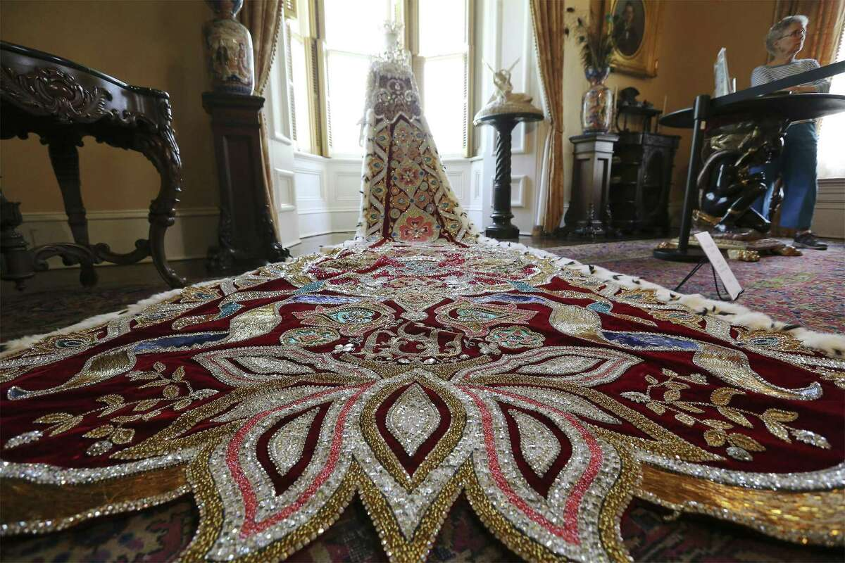 The elaborate train that weighs about 120 pounds on a dress worn by Gloria Galt Steves as Queen of Court of the Lion and Dragon from 2004 is seen on display at the Steves Homestead on Thursday.