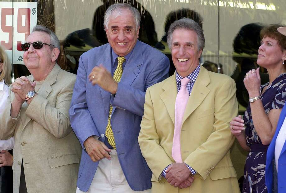 """Actor Tom Bosley (left), producer Garry Marshall, actor Henry Winkler and actress Erin Moran of the television show """"Happy Days"""" in 2001. Photo: E.J. Flynn / Associated Press 2001"""