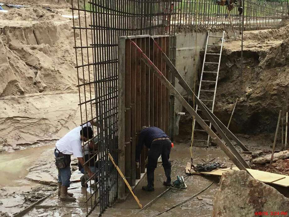 Crews work on a concrete wall that will replace the wooden bulkhead underneath Buffalo Springs Bridge. The wall will hold the slopes up and back to prevent future erosion and problems seen during May 2016 flooding, according to Jones and Carter Project Engineer for the city of Montgomery Chris      Roznovsky. Photo: Jones And Carter Submitted Photo