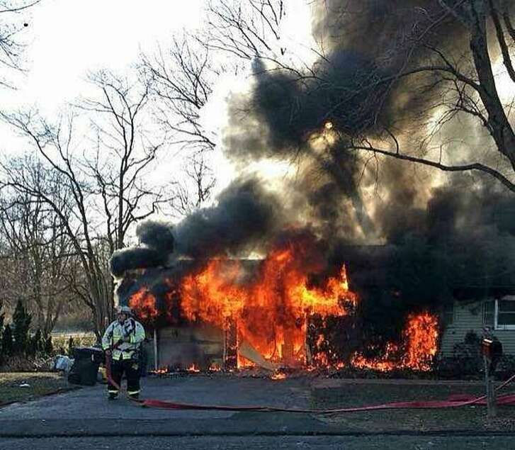 A portable propane heater is believed to have started an intense fire that heavily damaged a Poplar Street house on Monday, March 26, 2018 in Trumbull, Conn..The fire that started around 8 a.m. in the garage, spread to part of the house at 82 Poplar St. The one person inside the house at the time managed to escape safely.