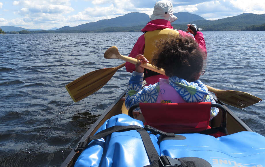 Even if your paddle technique isn't perfect. there's still no better place than a canoe. From a family paddle on Middle Saranac Lake. (Herb Terns / Times Union) Photo: Picasa