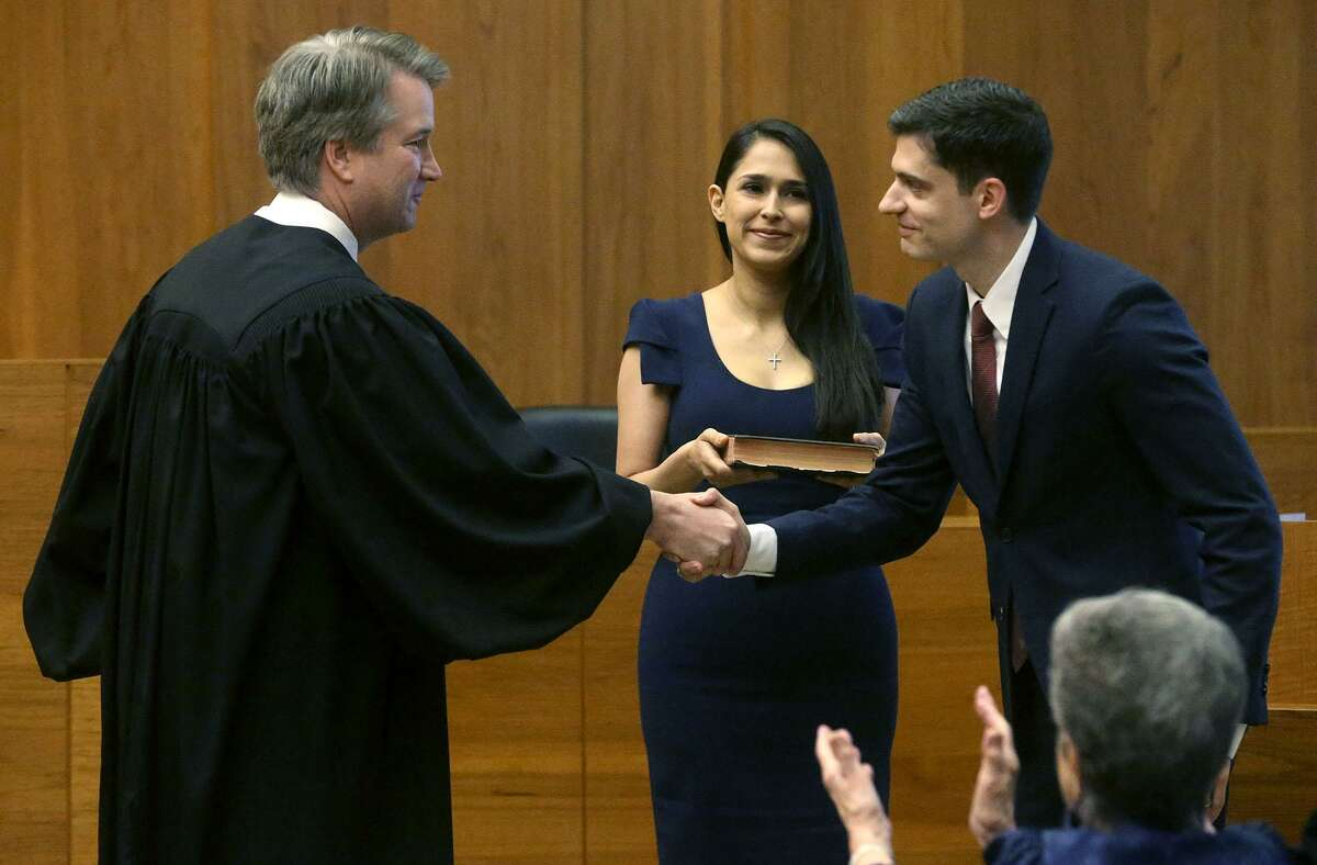 John Bash, right, selected Brett Kavanaugh, who was an appeals court judge at time, to swear him in as U.S. attorney for the Western District of Texas. Bash and his wife, Zina Bash, clerked for Kavanaugh.