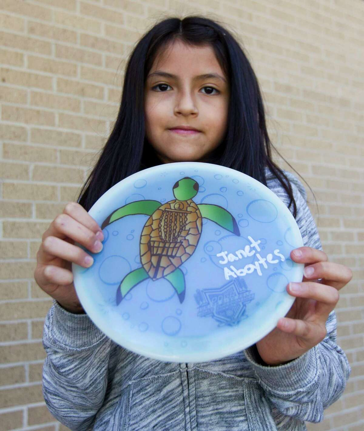 B.B. Rice third grader Janet Aboytes holds a disc of her design, which won a worldwide Facebook contest where sales from her disc support the 2018 PDGA Junior Worlds Championship to be held in July in Emporia, Kansas.