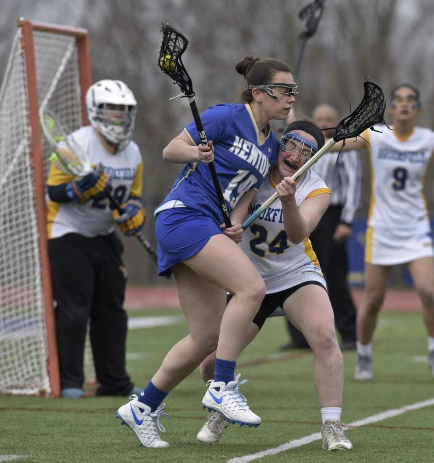 Newtown's Dylan Zahansky (19) and Brookfield's Sadie Smart (24) collide in front of the Brookfield goal in the girls lacrosse game between Newtown and Brookfield high schools, Thursday afternoon, April 12, 2018, at Brookfield High School, in Brookfield, Conn. Photo: H John Voorhees III / Hearst Connecticut Media / The News-Times