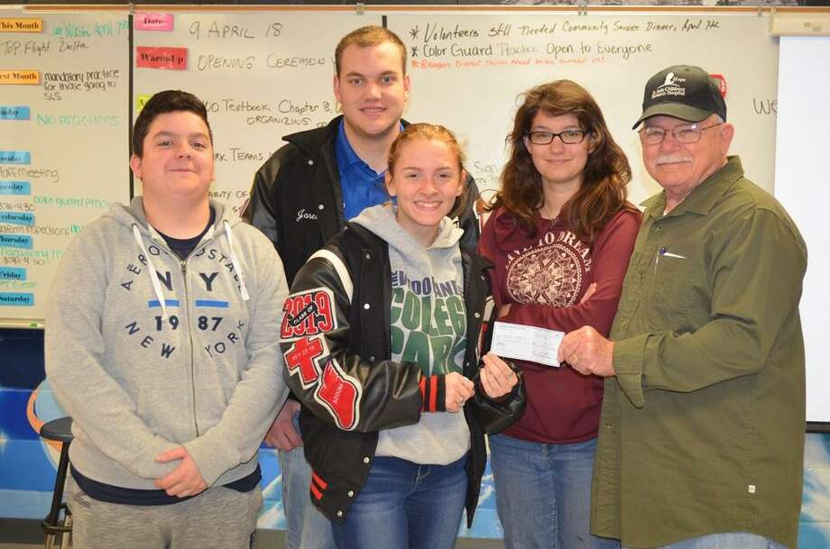 The Coldspring-Oakhurst High School Air Force JROTC program received a $500 donation from the American Legion Post 629 in Camilla. The check was presented to cadets by Mr. Verlon Powdrill, a representative of the Sons of the American Legion in Camilla - Post 629. Pictured left to right are Cadet/Staff Sergeant Jonathan Vasquez, Cadet/Major Jared Birmingham, Cadet/Major Jessie Beaver, Cadet/Airman Basic Anna Brown and Mr. Powdrill. Photo: Submitted / Submitted