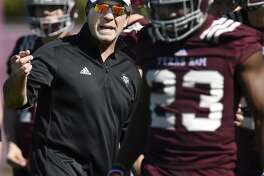 Texas A&M coach Jimbo Fisher talks to players during the first day of spring practice Tuesday, which will lead up to the spring game Saturday at Kyle Field.