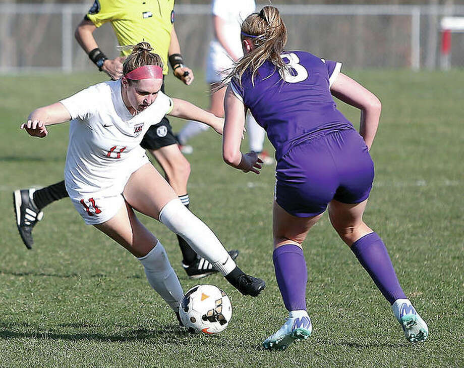 Alton's Brianna Hatfield (11) moves the ball against Collinsville's Catie Knutson Thursday during Southwestern Conference soccer action Thursday at Alton High School. Alton won 3-0. Photo:     Scott Kane | For The Telegraph
