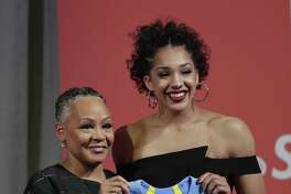 UConn's Gabby Williams, right, poses with WNBA President Lisa Borders after being selected with the No. 4 pick by the Chicago Sky on Thursday.