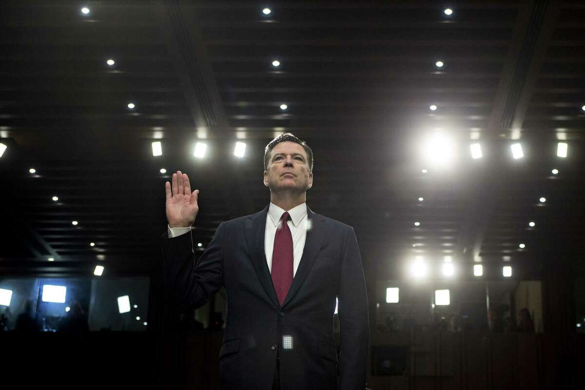 Former FBI director James Comey, above being sworn in at a Senate Intelligence Committee hearing in Washington in June 2017, details his discussions with President Trump in his new book. Must credit: Bloomberg photo by Andrew Harrer