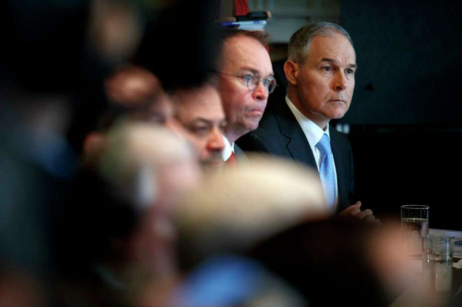 Scott Pruitt, right, the Environmental Protection Agency administrator, at a Cabinet meeting at the White House in Washington, April 9, 2018. Pruitt planned his travel to accrue frequent flier miles and insisted on staying in luxury hotels that were costlier than allowed by government standards, according to a six-page letter signed by five Democrats. (Tom Brenner/The New York Times) Photo: TOM BRENNER / NYTNS