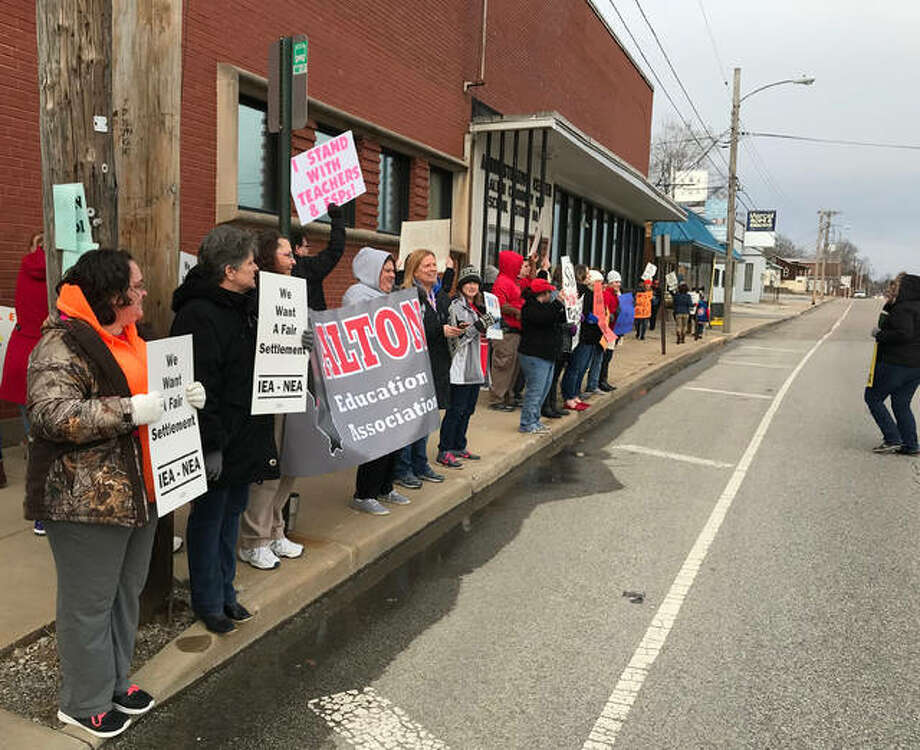 Alton Education Association members hold an informational picket outside the district's administration building ahead of a school board meeting last month. Photo:       Kelsey Schulz | The Telegraph