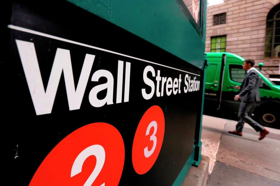 This April 5, 2018, photo shows a sign for a Wall Street subway station in New York. The U.S. stock market opens at 9:30 a.m. EDT on Thursday, April 12. (AP Photo/Richard Drew) Photo: Richard Drew / Copyright 2018 The Associated Press. All rights reserved.
