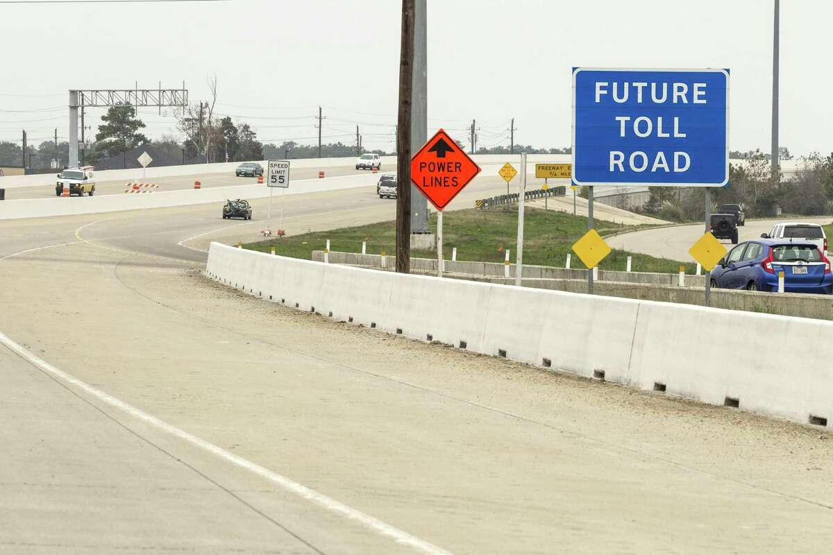 A future toll road sign stands alongside Texas 249 on Feb. 6, 2015, in Houston. ( Brett Coomer / Houston Chronicle )
