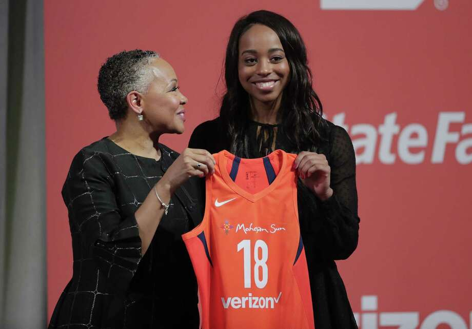 Duke's Lexie Brown, right, poses for a photo with WNBA President Lisa Borders after being selected as the ninth pick by the Connecticut Sun on Thursday. Photo: Julie Jacobson / Associated Press / Copyright 2018 The Associated Press. All rights reserved.