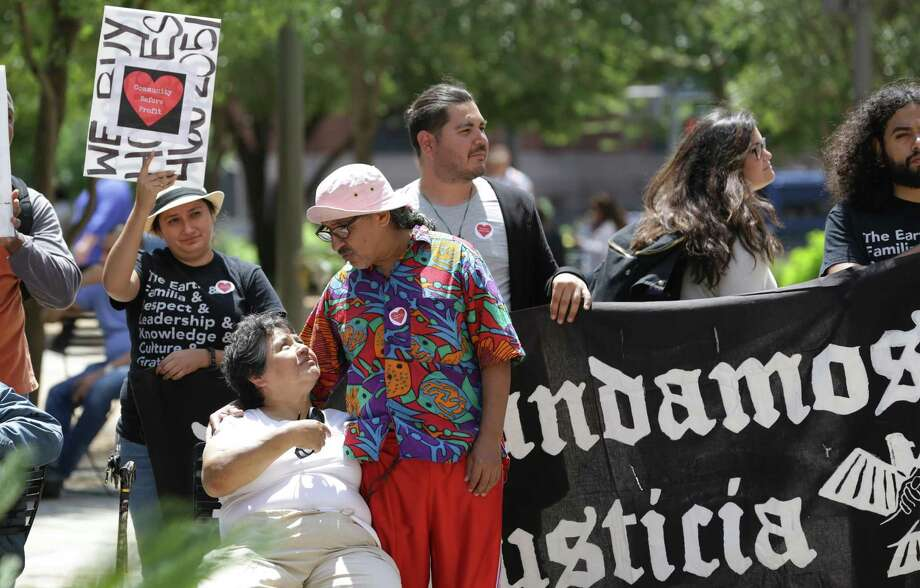 Residents of the Soapworks and Towne Center Apartments gather along with housing activists at Main Plaza on Thursday. The group demanded that the city purchase the apartments and convert them into permanent affordable housing. Photo: Bob Owen /San Antonio Express-News / ©2018 San Antonio Express-News