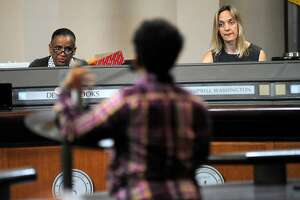Council members Kelsey Brooks, left, and Annie Campbell Washington listen to public comments during an Oakland City Council held at City Hall in Oakland, CA Wednesday, July 7, 2015.