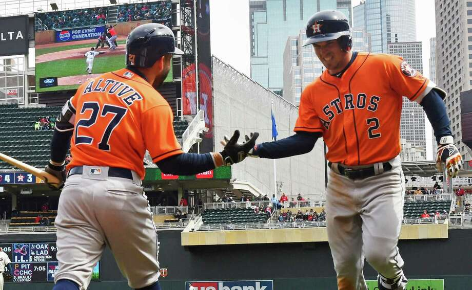 Alex Bregman (2), who didn't homer until May last year, is greeted by Jose Altuve after going deep Wednesday. Photo: Jim Mone, STF / Associated Press / Copyright 2018 The Associated Press. All rights reserved.