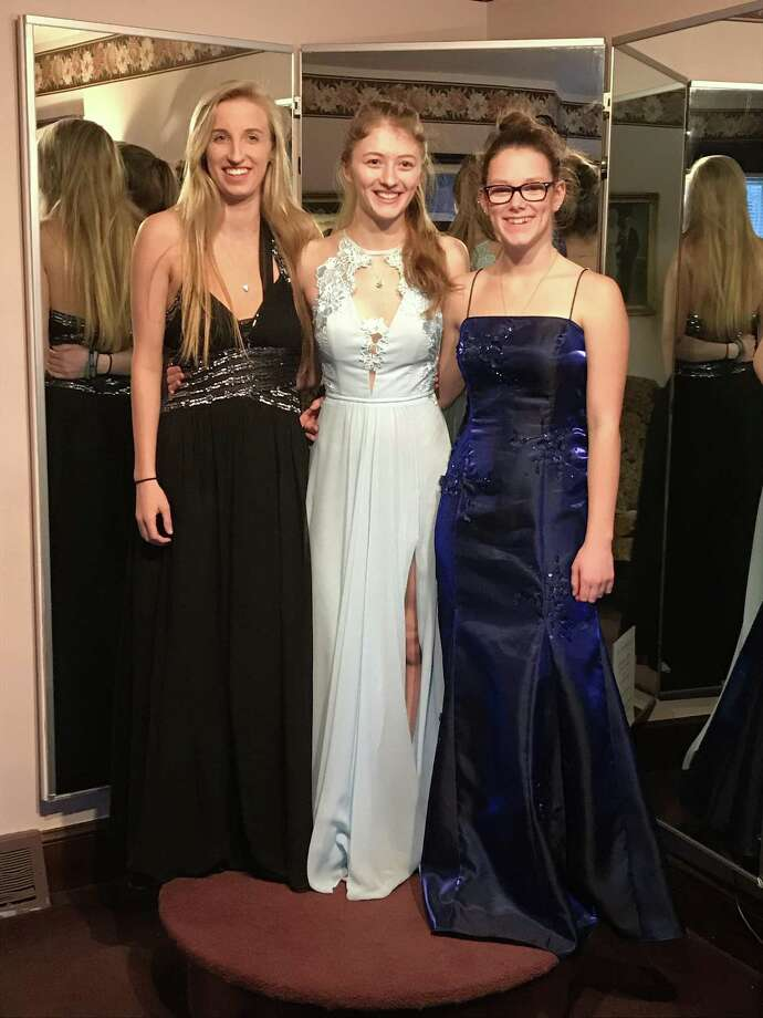 Thanks to the Princess at the Prom giveaway in Torrington, Shauna Cyr, Katrina Armstrong-Magill and Natalie Ariel received new prom dresses. Photo: Contributed Photo / Mary Kilmer