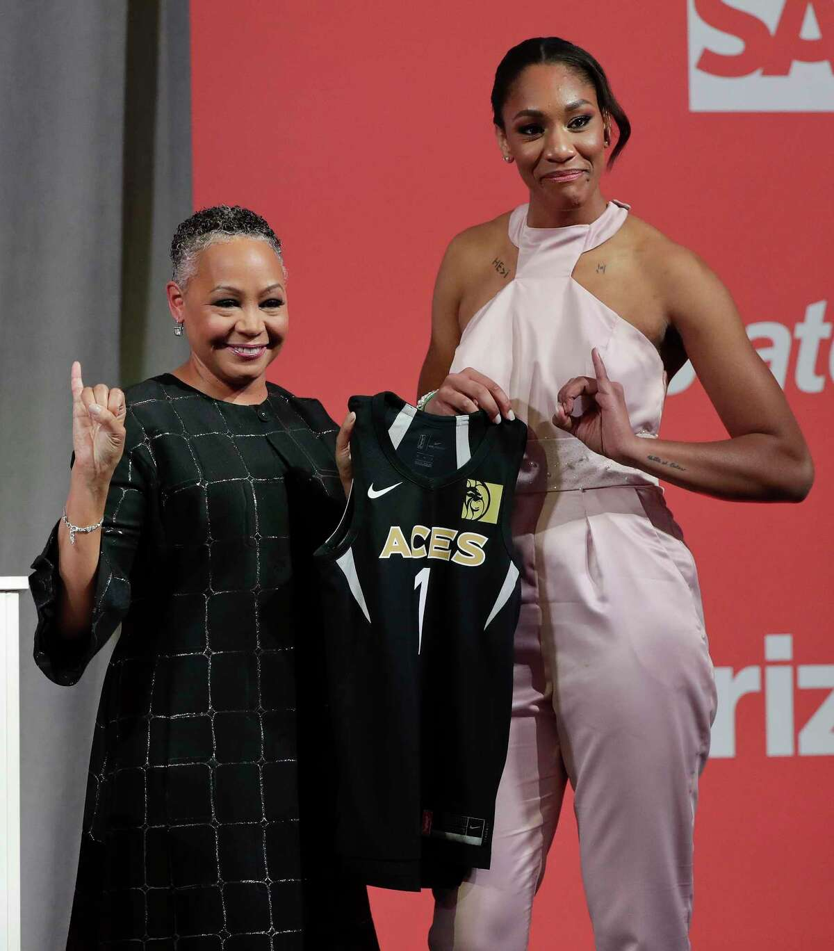 South Carolina's A'ja Wilson, right, poses for a photo with WNBA President Lisa Borders after being selected as the No. 1 overall pick by the Las Vegas Aces in the WNBA basketball draft, Thursday, April 12, 2018, in New York. (AP Photo/Julie Jacobson)