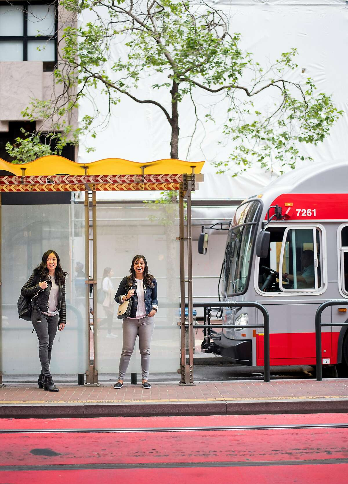 Muni Diaries co-founders Eugenia Chien (left) and Tara Ramroop, shown at a Market Street bus stop, operate a popular website and stage show.