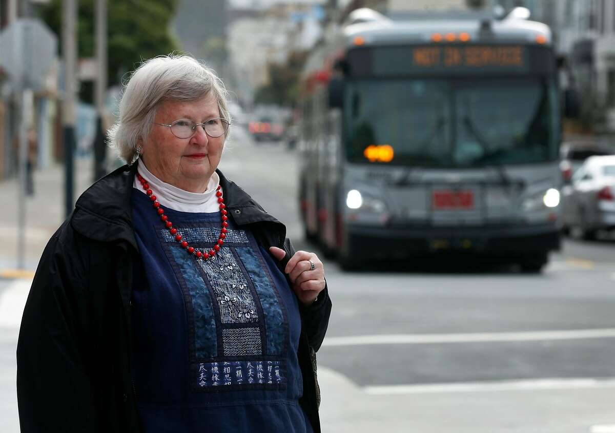 Jean Fowler waits to board a Muni bus for a ride to USF where she takes classes for seniors at the Fromm Institute in San Francisco, Calif. on Tuesday, April 10, 2018. Fowler has traveled on all but one of Muni's bus lines and has documented her experiences in