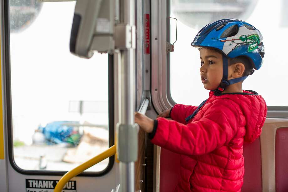 Three-year-old Ayan Mathur rides a bus with his father, Uday. Photo: Brian Feulner / Special To The Chronicle