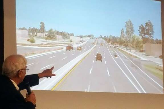 TIRZ10 chairman, Stan Sarman, shows a simulation of how Northpark Drive may look after the first phase of the Northpark Drive expansion project occurs.