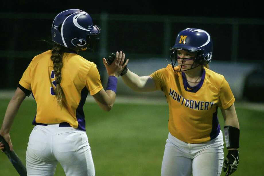 Montgomery's Natalie Hasselmeir (14) congratulates Demi Krikorian (3) for scoring a run during the softball game on Friday, March 9, 2018, at Montgomery High School. (Michael Minasi / Houston Chronicle) Photo: Michael Minasi, Staff Photographer / © 2018 Houston Chronicle