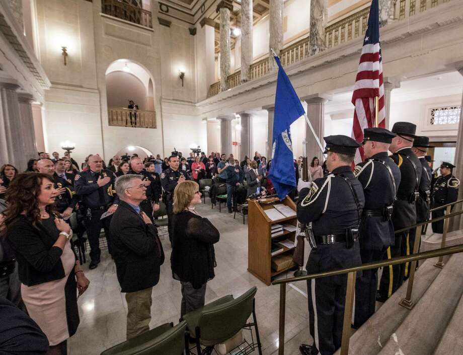 The Honor Guard from the Albany County Sheriff's Office and the Albany Police Department present the American Flag during the pledge of allegiance at the Ceremony of Remembrance in observance of National Crime Victims' Rights Week at the Albany County Courthouse Thursday April 12, 2018  in Albany, N.Y. (Skip Dickstein/Times Union) Photo: SKIP DICKSTEIN / 20043425A