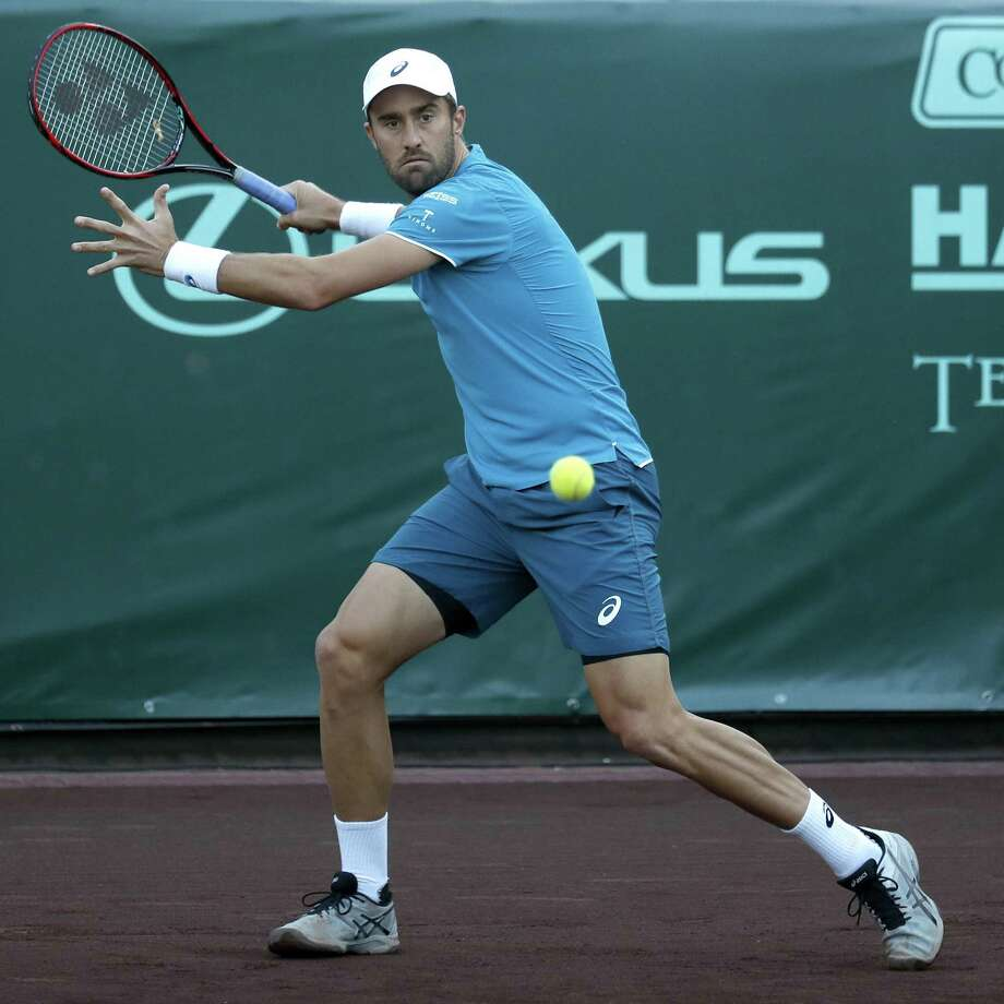 Sixth seed and defending champion Steve Johnson cocks his right arm for a forehand during his victory in three sets over Ernesto Escobedo on Tuesday. Johnson will play top seed John Isner in the quarterfinals Friday. Photo: Karen Warren, Staff / Houston Chronicle / © 2018 Houston Chronicle