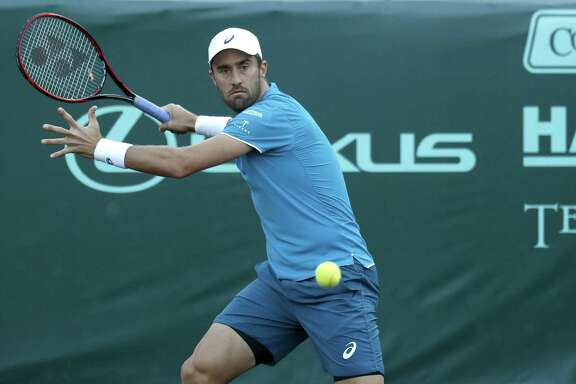 Sixth seed and defending champion Steve Johnson cocks his right arm for a forehand during his victory in three sets over Ernesto Escobedo on Tuesday. Johnson will play top seed John Isner in the quarterfinals Friday.