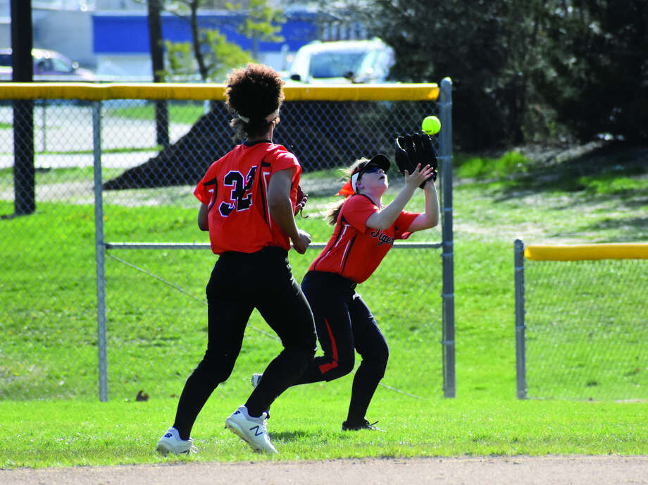 Edwardsville right fielder Brooke Webber makes a catch in front of second baseman Maria Smith in the first inning of Thursday's Southwestern Conference game against Belleville East in Belleville.
