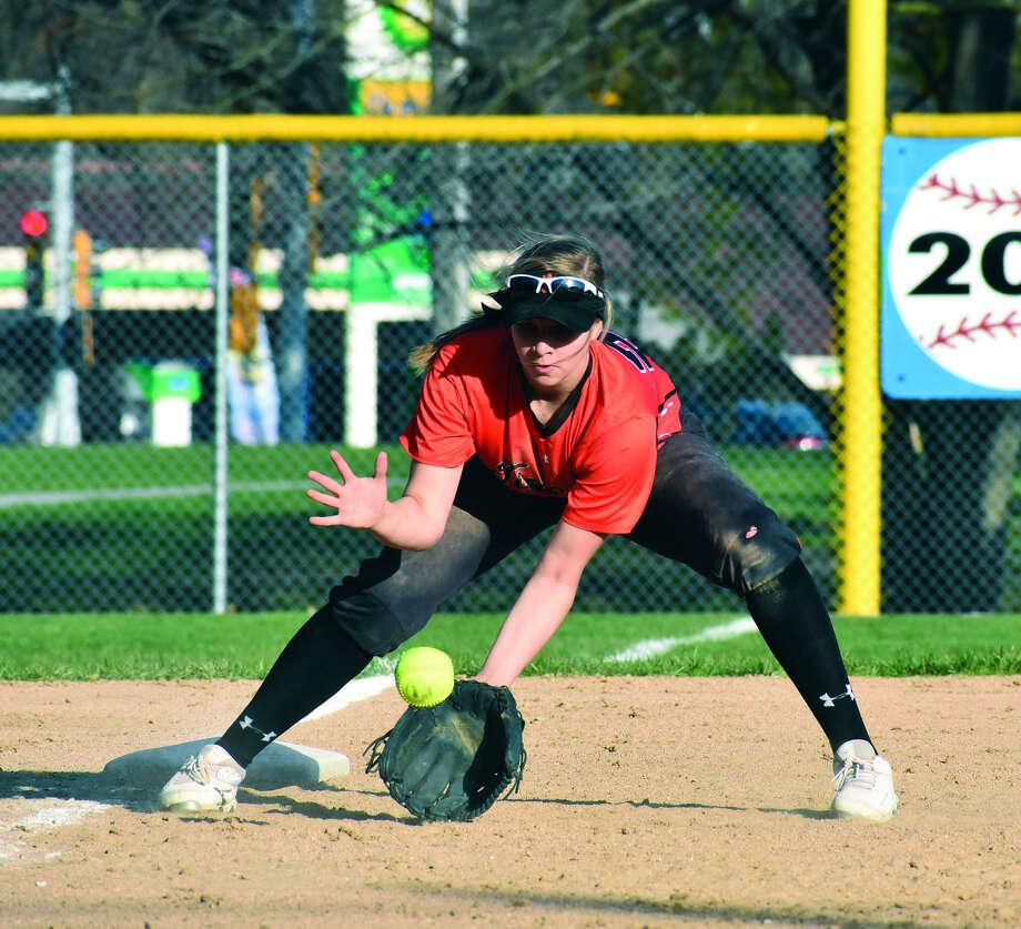 Edwardsville third baseman Lexi Gorniak fields a grounder in the seventh inning of Thursday's game against Belleville East in Belleville.