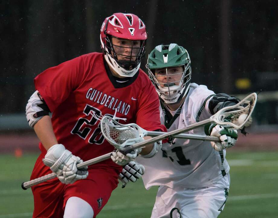 Shen's Dean Cannon stick checks Guilderland's Nicholas Popolizio during a game in Clifton Park, N.Y., on Thurs., Apr. 12, 2018. (Jenn March, Special to the Times Union) Photo: Jenn March / © Jenn March 2018 © Albany Times Union 2018