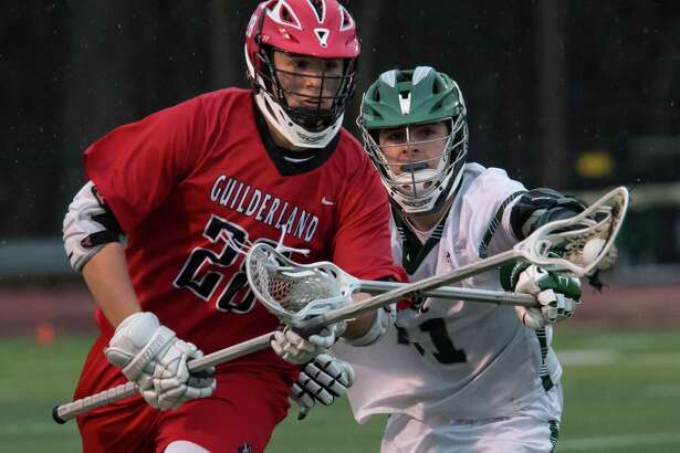 Shen's Dean Cannon stick checks Guilderland's Nicholas Popolizio during a game in Clifton Park, N.Y., on Thurs., Apr. 12, 2018. (Jenn March, Special to the Times Union)