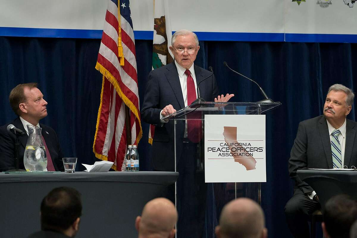 McGregor Scott, left, U.S. Attorney for the eastern district and former Sacramento County Sheriff John McGinness, right, listen to U.S. Attorney General Jeff Sessions during the 26th Annual Law Enforcement Legislative Day hosted by the California Peace Officers' Association on Wednesday, March 7, 2018 in Sacramento, Calif. (Randy Pench/Sacramento Bee/TNS)