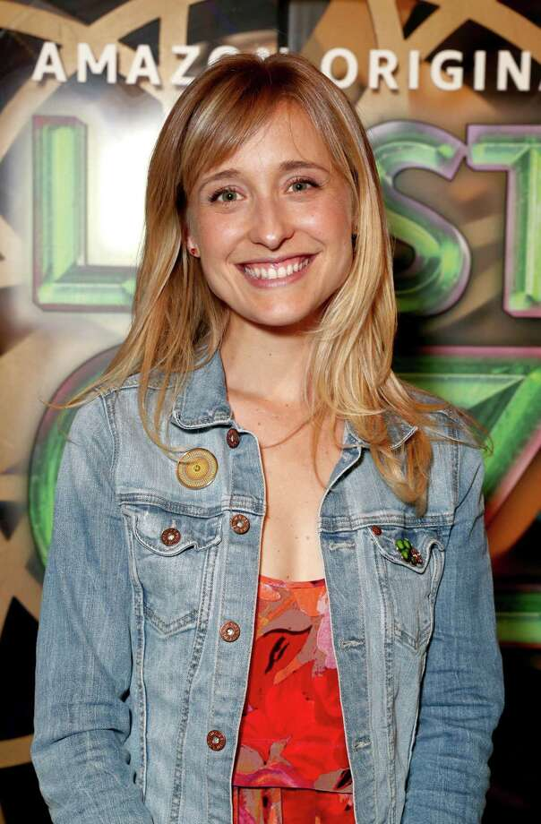 "Allison Mack, who has a home on Lape Road in Clifton Park, is an actress who is widely known for her role in the television series ""Smallville,"" which ran from 2001 to 2011 on the WB and the CW. She is listed in the federal criminal complaint against Keith Raniere as his unidentified co-conspirator. She is allegedly part of an internal group within NXIVM known as DOS or ""Dominus Obsequious Sororium,"" which means ""Master Over the Slave Women."" Photo: Todd Williamson / 2017 Todd Williamson"