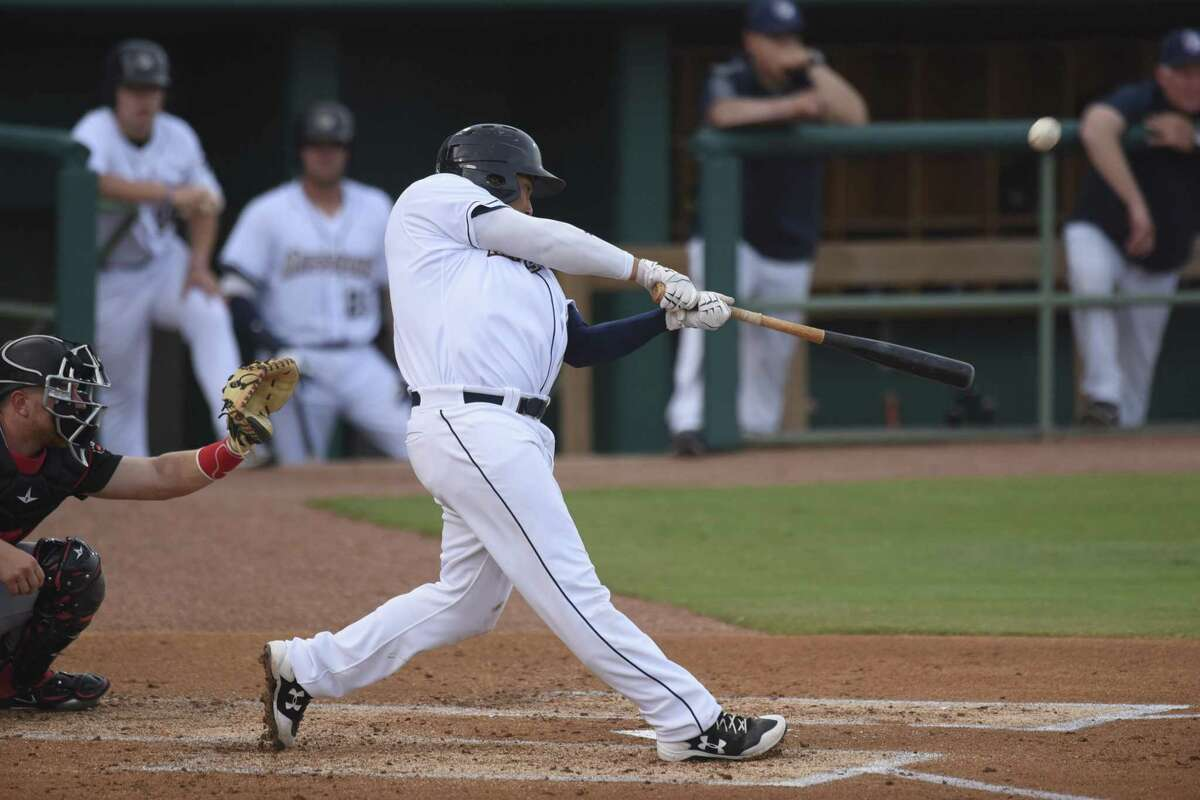 Josh Naylor swings and hits an inside-the-park home run during the San Antonio Missions home opener against the Arkansas Travelers at Wolff Stadium on Thursday, April 12, 2018.