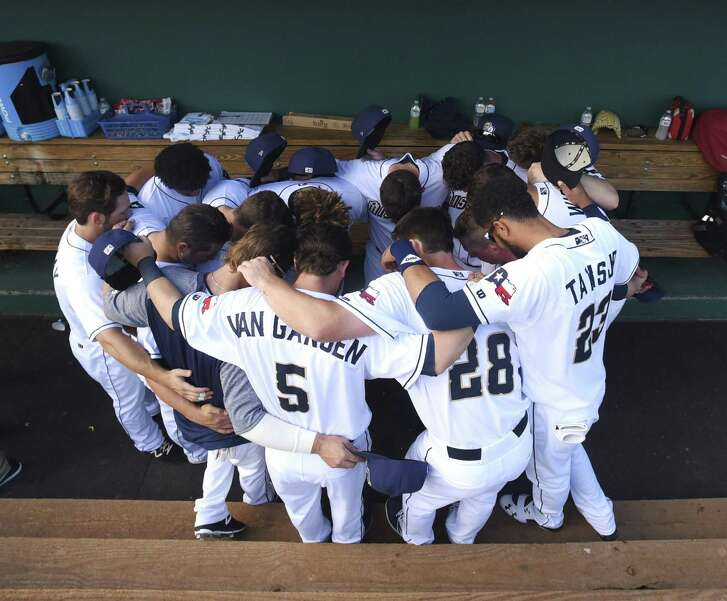 Members of the San Antonio Missions pray before their home opener against the Arkansas Travelers at Wolff Stadium on Thursday, April 12, 2018.