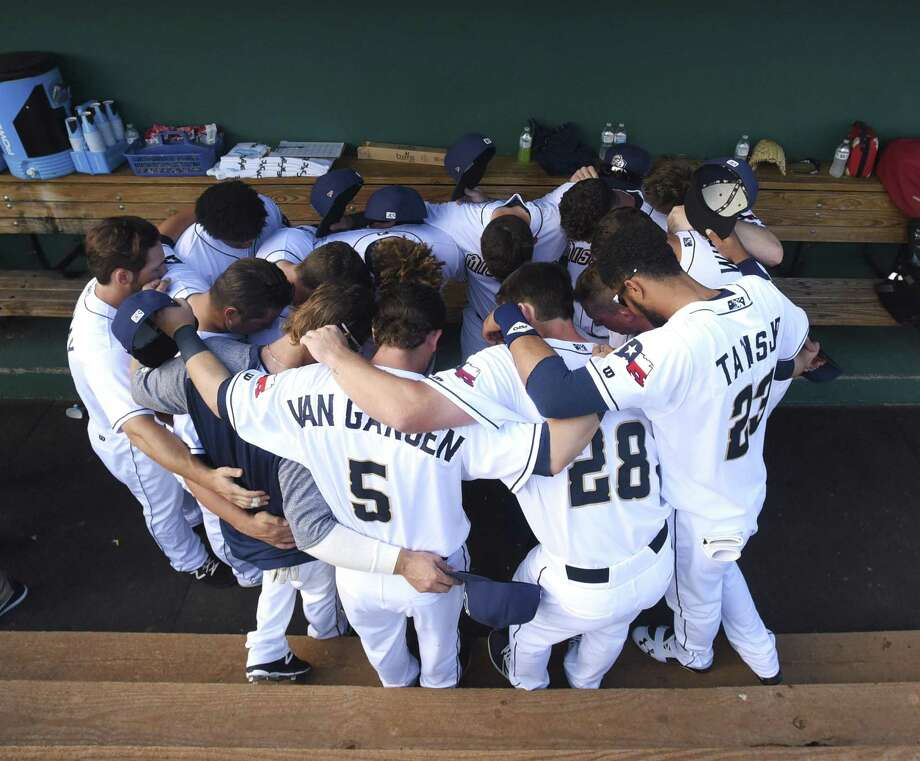 Members of the San Antonio Missions pray before their home opener against the Arkansas Travelers at Wolff Stadium on Thursday, April 12, 2018. Photo: Billy Calzada, Staff / San Antonio Express-News / San Antonio Express-News