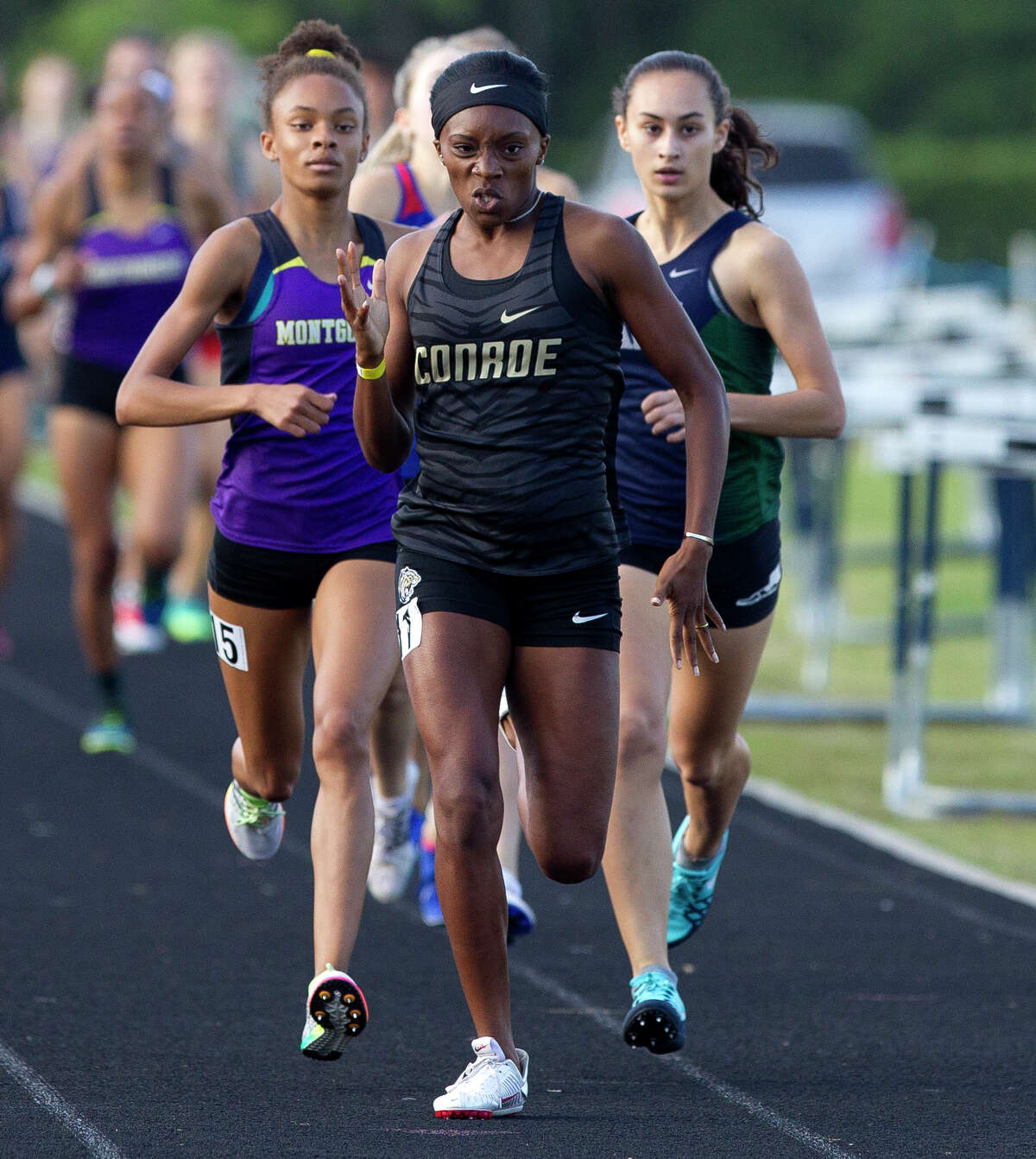 Conroe's Zena Utley finished first in the girls 800-meter run during the District 12-6A high school track meet at College Park High School, Thursday, April 12, 2018, in The Woodlands.
