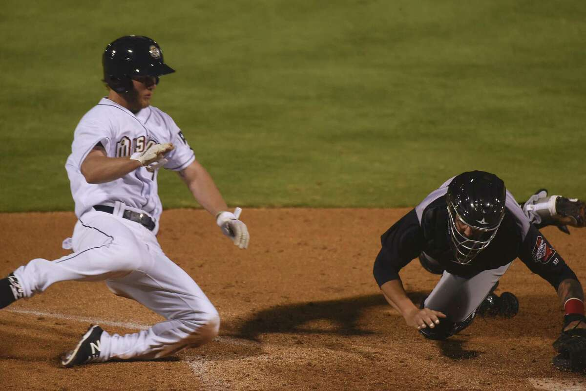 River Stephens of the San Antonio Missions scores the winning run in the bottom of the 10th inning as Arkansas Travelers catcher Joe DeCarlo can't handle the ball during the San Antonio Missions home opener at Wolff Stadium on Thursday, April 12, 2018.