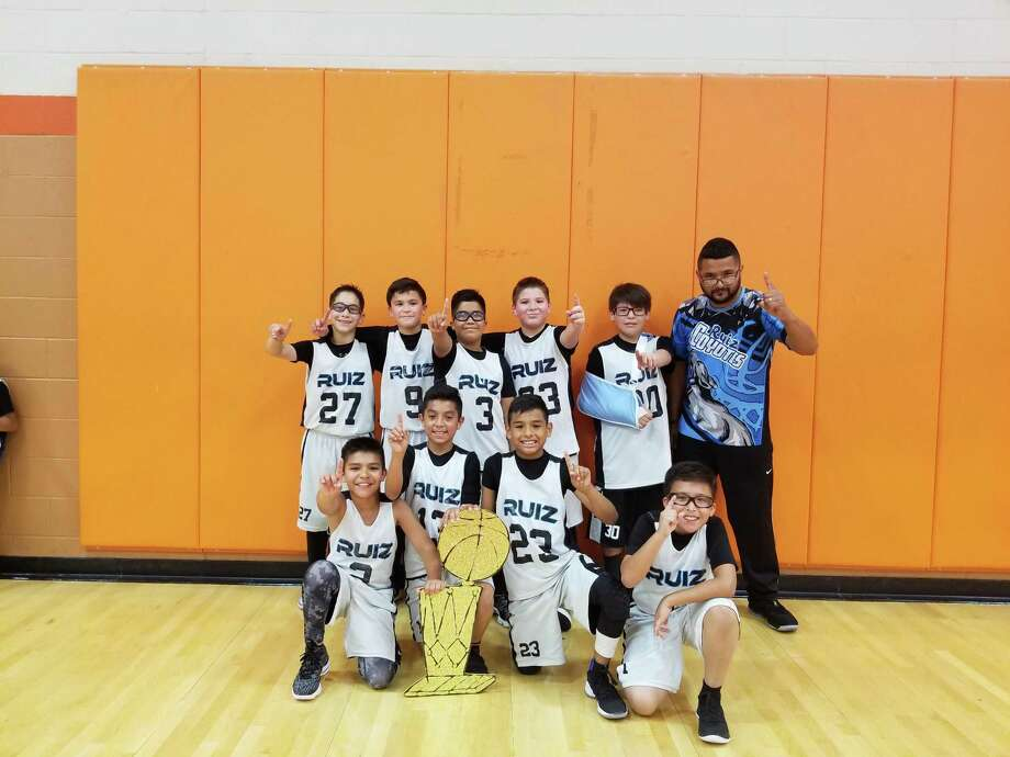The fifth grade Alicia Ruiz Elementary Coyotes won the 11A District Championship on Sunday for the Boys & Girls Club school league. In the back are Ethan Vela, Misael Viera, Fernando Zamarron, Juan Osorio, Isidro Mercado and coach Victor Lara. In the front are Timothy Garza, Sonny Vasquez, Jesse Arevalo and Alex Sanchez. Photo: Courtesy Photo