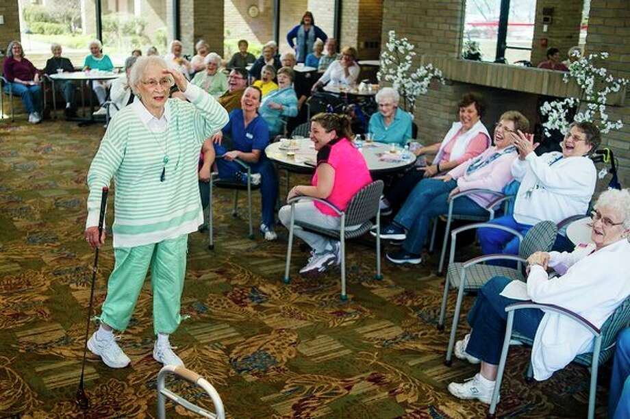 Joan C. Miller strikes a pose while participating in a Christopher & Banks fashion show on Thursday afternoon at Riverside Place Senior Living Community. For more photos from the fashion show, go to www.ourmidland.com. (Katy Kildee/kkildee@mdn.net)