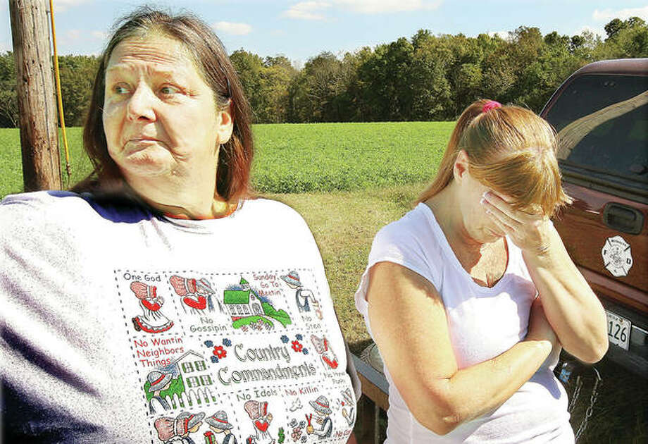 Linda Dean (left) and Bobbie Valdes, both sisters of Bonnie Woodward, react in September 2010 as they await word from law enforcement authorities searching for the missing Woodward. Roger Carroll of Jerseyville was charged Thursday in Woodward's death. Photo:       John Badman | Hearst Newspapers