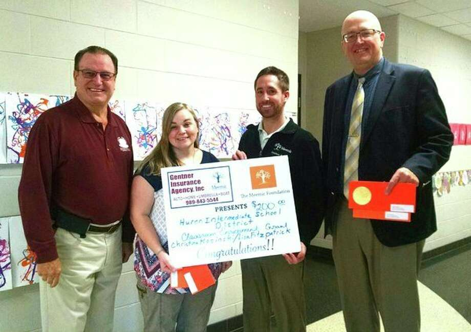 (From left): Charlie Gentner from Gentner Insurance, grant recipient Christina Kosinski, Dan Gentner from Gentner Insurance, and Huron Intermediate School District Superintendent Joe Murphy recently received a grant from the Meemic Foundation. Not pictured is Lisa Fitzpatrick. (Submitted photo)