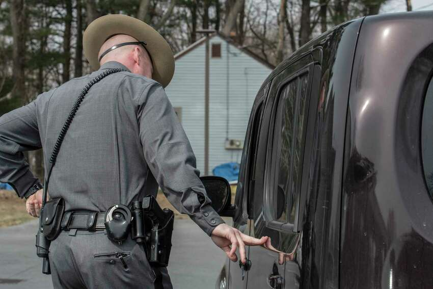 New York State Trooper Shawn Gould stops a motorist for using a hand-held cell phone while driving on Thursday, April 12, 2018, in Halfmoon, N.Y. (Skip Dickstein/Times Union)